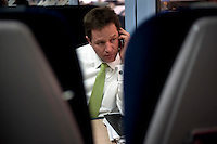 Nick Clegg, the Liberal Democrat party leader, travelling back to London on the train after a campaign stop in Chippenham, Wiltshire...