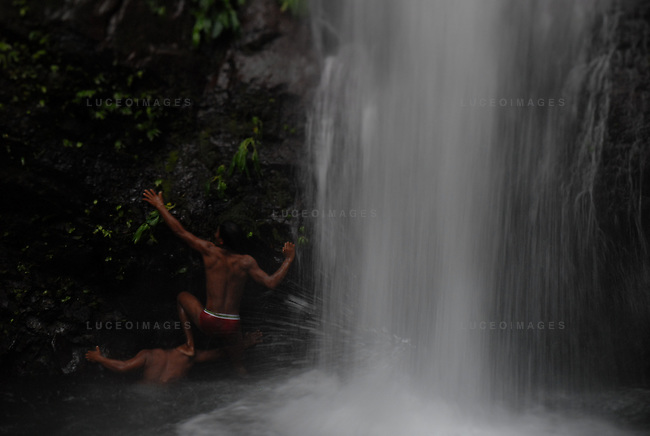 A Filipino man climbs the rock face of a water fall in the northern Philippines..**For more information contact Kevin German at kevin@kevingerman.com
