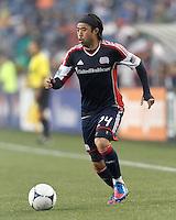New England Revolution midfielder Lee Nguyen (24) brings the ball forward. In a Major League Soccer (MLS) match, the New England Revolution defeated Chicago Fire, 2-0, at Gillette Stadium on June 2, 2012.
