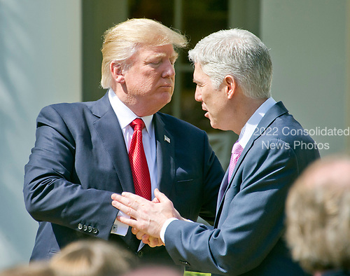 United States President Donald J. Trump, left, shakes hands with Associate Justice of the US Supreme Court Neil Gorsuch following the Oath of Office ceremony in the Rose Garden of the White House in Washington, DC on Monday, April 10, 2017.<br /> Credit: Ron Sachs / CNP<br /> (RESTRICTION: NO New York or New Jersey Newspapers or newspapers within a 75 mile radius of New York City)