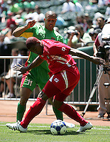 Roman Torres (5) tries to maintain possession against Mickael Antoine-Curier (11). Guadeloupe defeated Panama 2-1 during the First Round of the 2009 CONCACAF Gold Cup at Oakland Coliseum in Oakland, California on July 4, 2009.