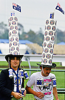 Supporters wearing oversized Fosters hats at the Melbourne Cup, Australia