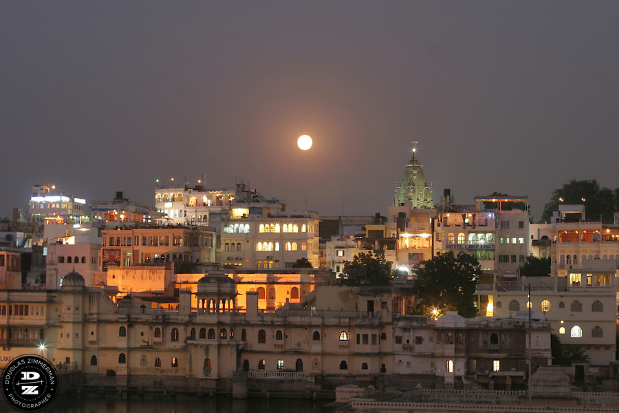 "A full moon rises over Udaipur, Rajasthan, India.  Udaipur is located in a valley surrounded by the Aravalli hills, and at its center is the Pichola Lake.  The scenic city has been described as ""the most romantic spot on the continent of India"" (by Colonel James Tod).  Photograph by Douglas ZImmerman"