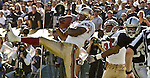 San Francisco 49ers defensive back Tony Parrish (33) intercepts ball intended for Oakland Raiders wide receiver Jerry Rice (80) on Sunday, November 3, 2002, in Oakland, California. The 49ers defeated the Raiders 23-20 in an overtime game.