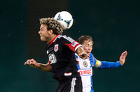 Nick DeLeon (18) of D.C. United goes up for a header with Brian Carroll (7) of the Philadelphia Union during a Major League Soccer game at RFK Stadium in Washington, DC. D.C. United tied the Philadelphia Union, 1-1.