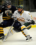 30 December 2007: University of Vermont Catamounts' defenceman Slavomir Tomko, a Senior from Zvolen, Slovakia, board checks Quinnipiac University Bobcats' forward Dan Travis, a Senior from Wilton, NH, at Gutterson Fieldhouse in Burlington, Vermont. The Bobcats defeated the Catamounts 4-1 to win the Sheraton/TD Banknorth Catamount Cup Tournament...Mandatory Photo Credit: Ed Wolfstein Photo