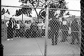 Santa Maria, California.USA.April 2005..Michael Jackson fans, who have gotten one of the 46 lottery tickets to enter the court room to witness the child abuse trial of pop singer Michael Jackson are placed into a fenced-in hold before entering the courthouse at 6:30 AM..Mr. Jackson, 46, denies all 10 charges against him, including child abuse. He faces up to 20 years in jail if convicted on all charges.