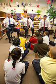 Chicago, Il - December 16, 2008 -- United States President-elect Barack Obama, center, gestures towards Vice President-elect Joseph Biden, left, as he, Biden, and newly nominated Secretary of Education former Chicago School Chief Arne Duncan, right, speak to schoolchildren at Dodge Renaissance Academy on Chicago's West Side on Tuesday, December 16, 2008..Credit: Ralf-Finn Hestoft - Pool via CNP