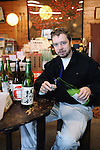 Master sake brewer Philip Harper from the United Kingdom pours himself a cup of sake at the Tamagawa Sake Brewery in Kyoto, Japan. The traditional market for sake is literally dying off and the supply side is fading too, as old masters retire without a new generation to take over the brewing vats.  Photographer: Robert Gilhooly