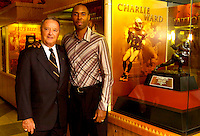 TALLAHASSEE, FL. 10/20/06-Florida State Football Coach Bobby Bowden, left, and Seminole athletic star Charlie Ward pose for photographers next to Ward's Heisman Trophy Friday in Tallahassee. Ward and Bowden are both being inducted into the College Football Hall of Fame in December. COLIN HACKLEY PHOTO