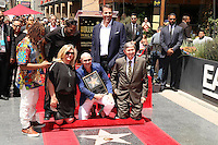 HOLLYWOOD, CA - JULY 15: Pitbull, pictured with Fariba Kalantari, Lil Jon, Luther Campbell and Tony Robbins, receives star at the Hollywood Walk of Fame in Hollywood, California on July 15, 2016. Credit: David Edwards/MediaPunch