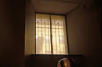 Window in basement apartment. Mystery fantasy intrigue