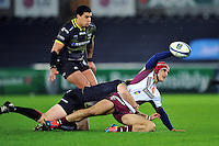 Paulin Riva of Bordeaux Begles looks to offload the ball after being tackled. European Rugby Champions Cup match, between the Ospreys and Bordeaux Begles on December 12, 2015 at the Liberty Stadium in Swansea, Wales. Photo by: Patrick Khachfe / JMP