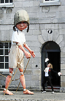 10/09/'10 Macnas performer, Debbie Wright pictured with a 15 foot high 8 year old boy explorer puppet at The National Museum of Ireland, Collins Barracks this afternoon as they prepare for the Saturday opening spetacular Absolut Fringe 16th Annual Fringe Festival. The free show opens tomorrow night at Collins Barracks at 8pm and runs until the 26th Sept..Picture Colin Keegan, Collins, Dublin.