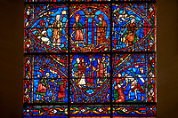 Medieval Windows of the Gothic Cathedral of Chartres, France, dedicated to the life of the Virgin Mary.  Bottom Left pruning of the vines, right Count Thibault VI. The top centre oval panel shows Anna and Joachim meet at the Golden Gate, below The high priest refuses the offerings of Joachim, left Annunciation to Joachim , right Annunciation to Anna . A UNESCO World Heritage Site.