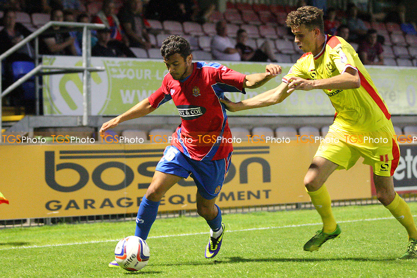 George Porter of Dagenham and Redbridge and Tom Flanaghan of MK Dons - Dagenham and Redbridge vs MK Dons, pre season friendly - 22/07/14 - MANDATORY CREDIT: Dave Simpson/TGSPHOTO - Self billing applies where appropriate - 0845 094 6026 - contact@tgsphoto.co.uk - NO UNPAID USE