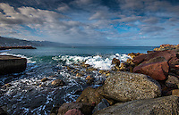 Fine Art Photograph of a seascape scene in Puerto Vallarta Mexico. The morning lighting was perfect as the long rays of the morning sun brought out the textures and details of clouds, and the ocean waves, and rocky shoreline.