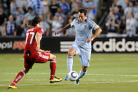 Davy Arnaud (blue) Sporting KC, Bratislav Ristic Chicag Fire...Sporting KC were held to a scoreless tie with Chicago Fire in the inauguarl game at LIVESTRONG Sporting Park, Kansas City, Kansas.