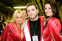 &quot;Dr. Slob&quot; and two Wingettes in his entourage at the 14th annual Wing Bowl, held in Philadelphia on February 3, 2006 at the Wachovia Center.<br /> <br /> The Wing Bowl is a competitive eating event in which eaters try and down the most hot wings in 30 total minutes in front of a crowd of 10,000 plus people.  The real show however is all around the eaters, from the various scantily clad women (known as &quot;Wingettes&quot;) that make up eaters' entourages, to the behavior of the fans themselves.