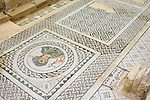 Remains of ancient mosaic floor ornament at House of Eustolios. Woman with Roman foot measuring stick. The Archaeological Site of Kourion, Cyprus.