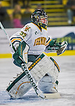 24 November 2012: University of Vermont Catamount goaltender Billy Faust, a Freshman from Alta Loma, CA, warms up prior to facing the University of Minnesota Golden Gophers at Gutterson Fieldhouse in Burlington, Vermont. The Catamounts fell to the Gophers 3-1 in the second game of their 2-game non-divisional weekend series. Mandatory Credit: Ed Wolfstein Photo