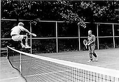 Steve Ford leaps over the tennis net at Camp David near Thurmont, Maryland on September 1, 1974 to congratulate his dad, United States President Gerald R. Ford on his victory in their match.<br /> Mandatory Credit: David Hume Kennerly / White House via CNP