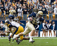 30 September 2006: Pitt defensive lineman Gus Mustakas scores on a 9-yard interception return.  The Pitt Panthers defeated the Toledo Rockets 45-3 on September 30, 2006 at Heinz Field, Pittsburgh, Pennsylvania.