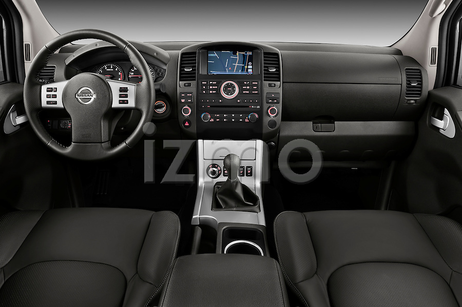 dashboard view of a 2010 Nissan Navara LE 4 door Pick-Up Truck