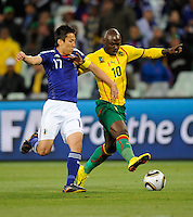 Makato Hasebe of Japan and Achille Emana of Cameroon