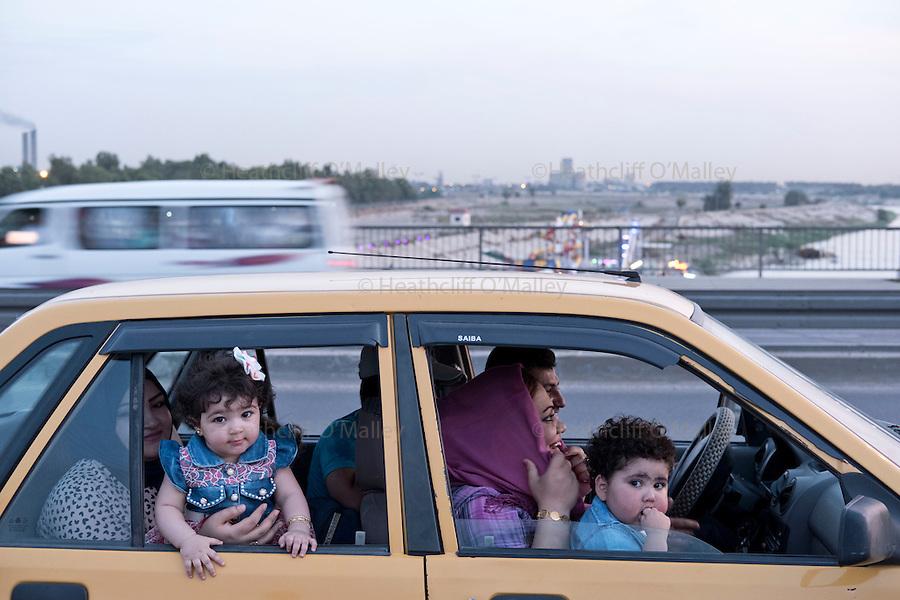 Mcc0070043 . Daily Telegraph<br /> <br /> DT News<br /> <br /> A family sitting in their car on Jadriyha bridge , Baghdad . <br /> <br /> Baghdad 13 May 2016