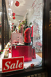 Nov. 23, 2012 - Merrick, New York, U.S. - All Dazzle, a women's fashion and accessory boutique on Long Island, has sales, and its front window is decorated in red, white, and black for the winter holidays.