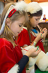 Young girls, dressed in festive attire, create bracelets at the Annual Holiday Barn Lighting at Westwind Barn in Los Altos Hills Dec. 2.