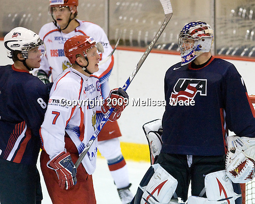 Jake Gardiner (US - 8), Viatcheslav Kulemin (Russia - 7), Jack Campbell (US - 1) - Team USA defeated Team Russia 6-1 in their second game during the 2009 USA Hockey National Junior Evaluation Camp on Wednesday, August 12, 2009, in the USA (NHL-sized) Rink in Lake Placid, New York.