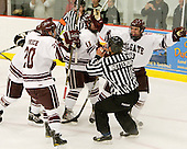 Mike McCann (Colgate - 28) (far right) celebrates after being awarded a goal despite being given a goalie interference minor at the same time. - The host Colgate University Raiders defeated the Army Black Knights 3-1 in the first Cape Cod Classic at the Hyannis Youth and Community Center in Hyannis, MA.