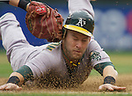 Oakland Athletics' Daric Barton barely makes it back to first base while being tagged by Seattle Mariners' Casey Kotchman in the fourth inning of the opening home game of the season  at SAFECO Field in Seattle April 12, 2010. The Athletics beat the Mariners 4-0.  Jim Bryant Photo. &copy;2010. ALL RIGHTS RESERVED.