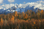 Twin Peaks, near Palmer, Alaska sits majestically among fall colors and a dappled sky of clouds in the fall.