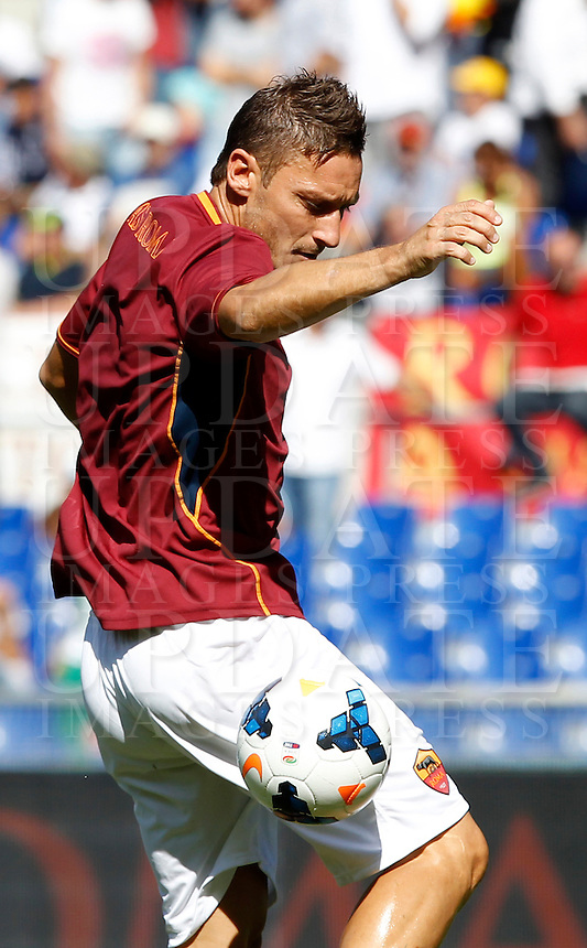 AS Roma forward Francesco Totti warms up prior to the start of the Italian Serie A football match between AS Roma and Lazio, at Rome's Olympic stadium, 22 September 2013.<br /> UPDATE IMAGES PRESS/Isabella Bonotto