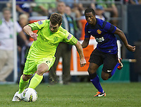 Seattle Sounders FC forward Mike Fucitodribbles the ball during play against Manchester United at CenturyLink Field in Seattle Wednesday July 20, 2011. Manchester United won the match 7-0.