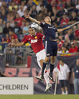 Manchester United FC defender Nemanja Vidic (15) and New England Revolution forward Rajko Lekic (10) battle for head ball. In a Herbalife World Football Challenge 2011 friendly match, Manchester United FC defeated the New England Revolution, 4-1, at Gillette Stadium on July 13, 2011.