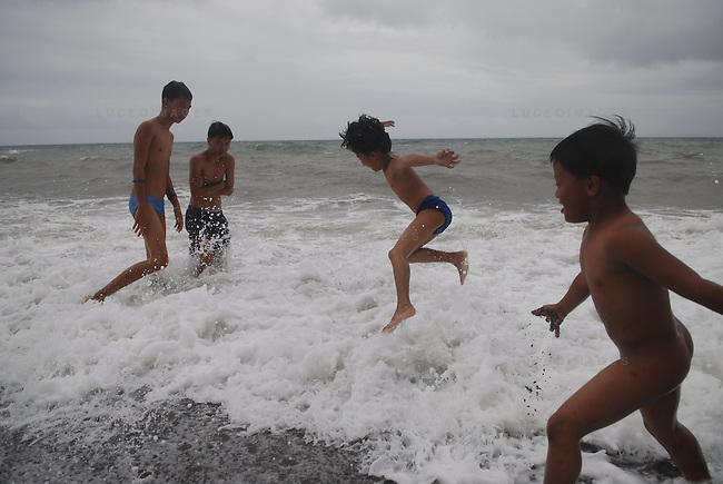 Children play on the beach in Ilocos Norte, Philippines..**For more information contact Kevin German at kevin@kevingerman.com