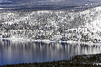 24 February 2008: Lake reflection of snow covered mountains after a late winter storm in Lake Tahoe, Truckee Nevada California border in the Sierra Mountains.