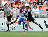 Andy Najar (14) of D.C. United fights for the ball with Sanna Nyassi (11) of the Montreal Impact during the game at RFK Stadium in Washington DC.   D.C. United defeated the Montreal Impact, 3-0.