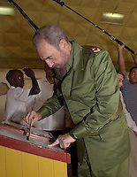 Fidel Castro it introduces the vote in the electoral urn in the electoral school of Santiago de Cuba, January 19/2003. . Credit: Jorge Rey/MediaPunch