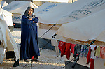 A woman in the Zaatari Refugee Camp, located near Mafraq, Jordan. Opened in July, 2012, the camp holds upwards of 50,000 refugees from the civil war inside Syria. International Orthodox Christian Charities and other members of the ACT Alliance are active in the camp providing essential items and services.