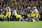 Sept. 22, 2012; Notre Dame defensive end Stephon Tuitt brings down Michigan quarterback Denard Robinson during the first quarter.  Photo by Barbara Johnston/University of Notre Dame