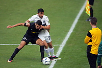 Mario Barcia holds off Emiliano Tade during the Oceania Football Championship final (second leg) football match between Team Wellington and Auckland City FC at David Farrington Park in Wellington, New Zealand on Sunday, 7 May 2017. Photo: Mike Moran / lintottphoto.co.nz