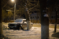 A car stands parked on a sidewalk in Ufa, Bashkortostan, Russia.