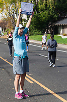 Volunteer encouraging runners in the California International Marathon 2014.