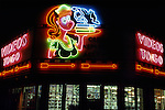 Videos To Go  retro styled neon sign  lit up at night over video rental shop in Los Angeles, CA