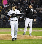 CHICAGO - SEPTEMBER 27:  Mark Buehrle #56 walks off the field after manager Don Cooper #21 of the Chicago White Sox removes him from the game during the eighth inning against the Toronto Blue Jays on September 27, 2011 at U.S. Cellular Field in Chicago, Illinois.  Buehrle's appearance could be his last in a White Sox uniform. The White Sox defeated the Blue Jays 2-1.  (Photo by Ron Vesely)   Subject: Mark Buehrle;Don Cooper..